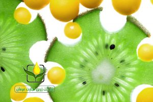 Close up of kiwi slices and vitamin pills isolated on white, healthcare concept